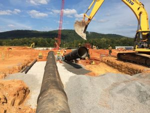 AMERICAN Ductile Iron Pipe being installed under the new treatment facility. Photo provided by Tetra Tech, Inc.