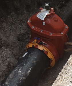 AMERICAN Flow Control's resilient wedge gate valves with ALPHA restrained joint ends are used on a pipe replacement project for the city of Manning, South Carolina. ALPHA's single-bolt design saves time and money.