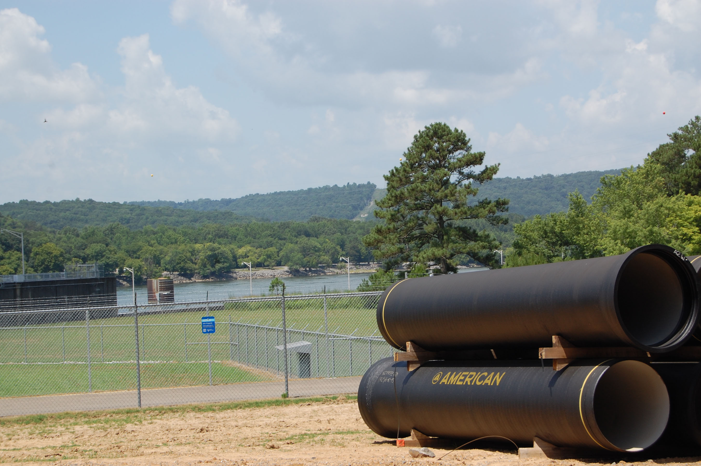 AMERICAN Ductile Iron Pipe waiting to be installed along Lake Guntersville.