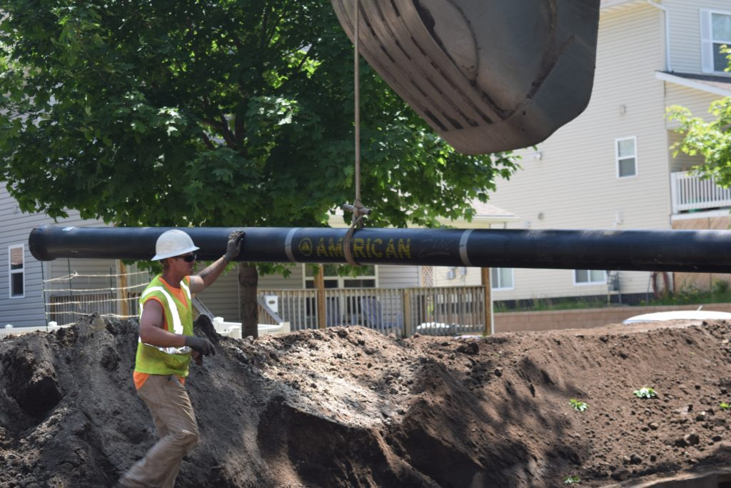 AMERICAN Ductile Iron Pipe with zinc coating being installed by Danner Inc. in Saint Paul, Minnesota.